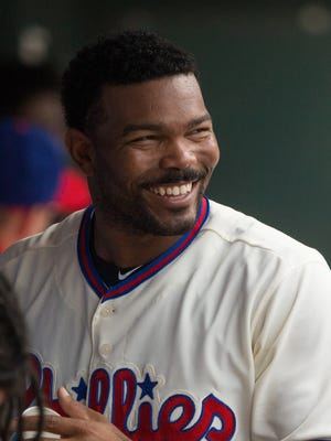 Philadelphia Phillies left fielder Howie Kendrick smiles while in the dugout between innings in a game against the Milwaukee Brewers at Citizens Bank Park.
