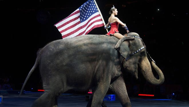 A performer rides an elephant holding a U.S. flag during a Ringling Bros. and Barnum & Bailey Circus performance in Washington, D.C. on March 19, 2015.