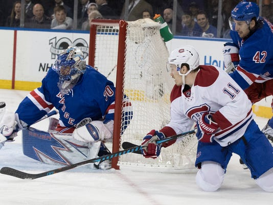 New York Rangers goalie Henrik Lundqvist (30) tends net against a shot by Montreal Canadiens right wing Brendan Gallagher (11) during the first period of Game 6 of a first-round NHL hockey Stanley Cup playoff series, Saturday, April 22, 2017, at Madison Square Garden in New York. (AP Photo/Mary Altaffer)