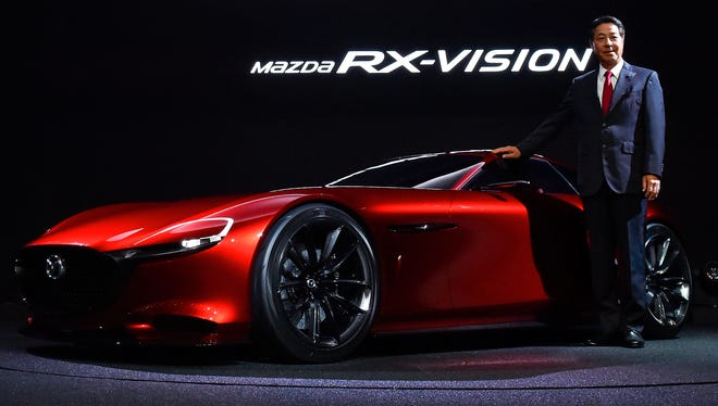 Masamichi Kogai, CEO of Mazda Motor, during the Tokyo Motor Show 2015 with the rotary car