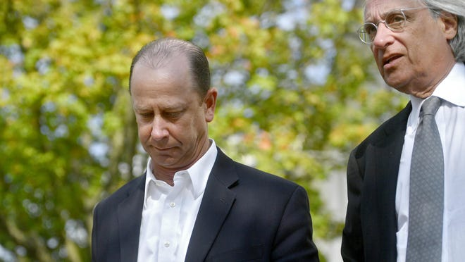 Jim Piazza talks with attorney Tom Kline after another day of the preliminary hearing for the members of Beta Theta Pi on Wednesday, Aug. 30, 2017 at the Centre County Courthouse in Bellefonte, Pa. (Abby Drey/Centre Daily Times via AP)