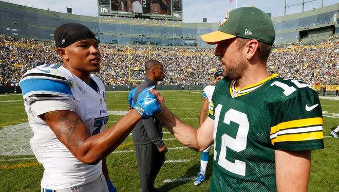 The Green Bay Packers' Aaron Rodgers, right, talks to the Detroit Lions' Marvin Jones after a game Sept. 25, 2016, in Green Bay, Wis.