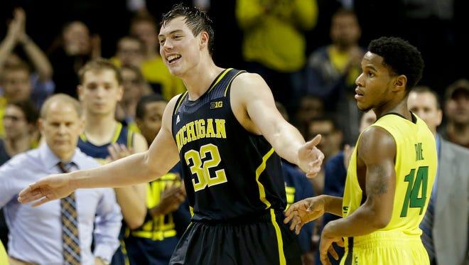 Michigan's Ricky Doyle (32).