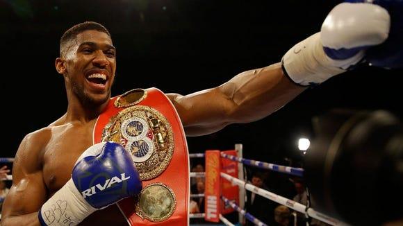 Anthony Joshua owns the WBA, IBF and WBO championship belts.