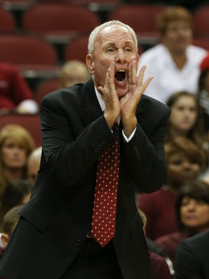 Bellarmine head coach Scott Davenport shouts instructions to his players during their game against U of L at the KFC Yum! Center.Nov. 1, 2015