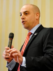 York County District Attorney candidate Dave Sunday gives his opening statement during a debate with fellow Republican candidate Jonelle Eshbach during the York Rotary Club meeting at Country Club of York in Spring Garden Township, Wednesday, April 12, 2017. Dawn J. Sagert photo