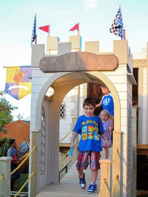 Jacob Burgess, 7, walks out of his castle playhouse on Wednesday in Gallatin.