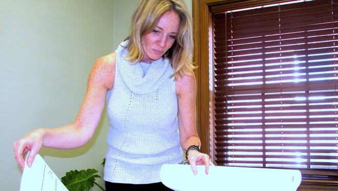 Nicolette Wagoner, Chemung County's new planning director, looks over plans for an Elmira Southside development project.