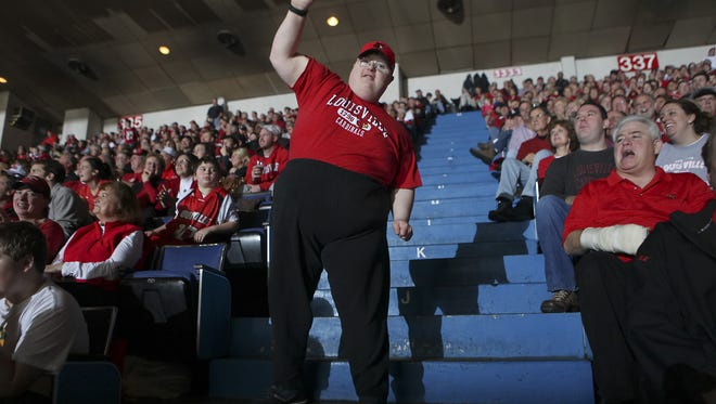 Scott Spicer is known to boogie during the Boogie Cam segment at Louisville men's basketball games.  He's shown here in 2010 at Freedom Hall.