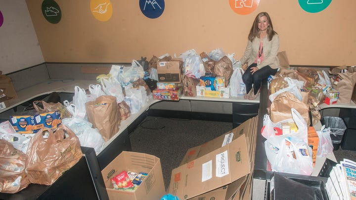 """Montgomery Advertiser reporter Kym Klass with donations collected for """"Project 7: Feeding our Future."""""""