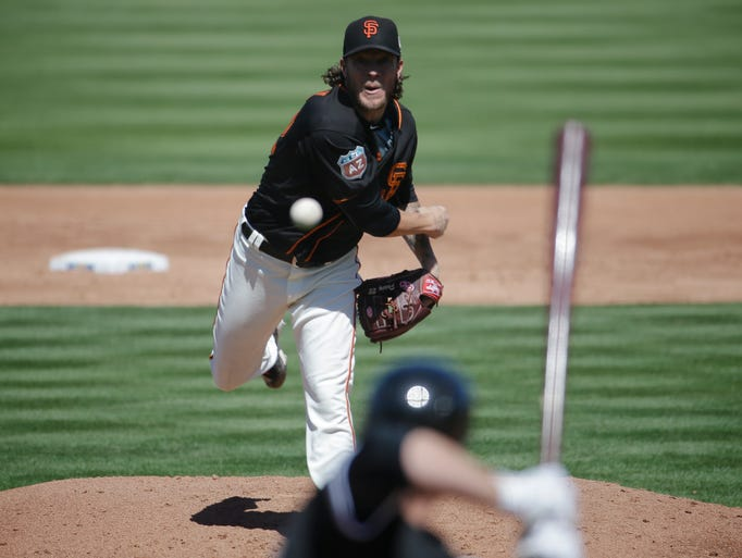 San Francisco Giants' Jake Peavy throws in the first