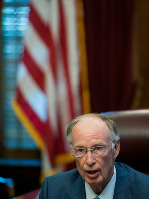 Governor Robert Bentley speaks with the media about the weeks events at the state capitol building in Montgomery, Ala., on Friday morning April 29, 2016.