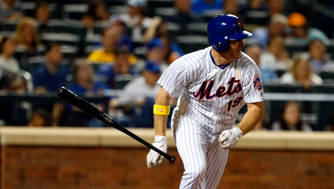 New York Mets right fielder Jay Bruce (19) tosses his bat after base hit in the fourth inning against the Washington Nationals at Citi Field on Sept. 2nd, 2016.
