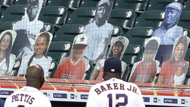 Houston Astros third base coach Gary Pettis and manager Dusty Baker Jr. look up into he stands at photo cutouts of former Negro League players during a celebration o the 100th Anniversary of the Negro Leagues before a game against the Seattle Mariners on Sunday, August 16, 2020 at Minute Maid Park.