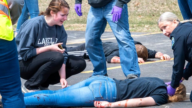 Elkhart Lake-Glenbeulah High combats distracted driving with a mock crash on April 26 in the high school parking lot.