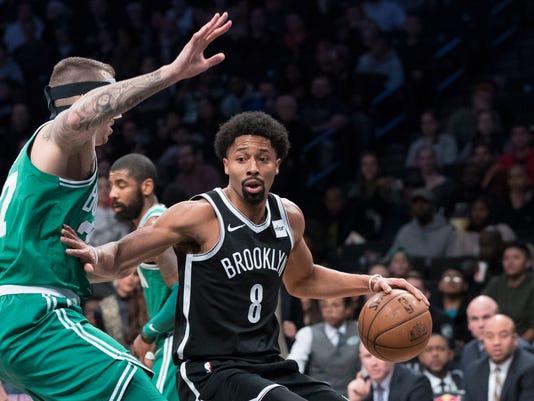 Boston Celtics forward Semi Ojeleye (37) guards Brooklyn Nets guard Spencer Dinwiddie (8) during the first half of an NBA basketball game Saturday, Jan. 6, 2018, in New York. (AP Photo/Mary Altaffer)