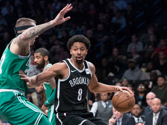 Boston Celtics forward Semi Ojeleye (37) guards Brooklyn Nets guard Spencer Dinwiddie (8) during the first half of an NBA basketball game Saturday, Jan. 6, 2018, in New York. (AP Photo/Mary Altaffer)