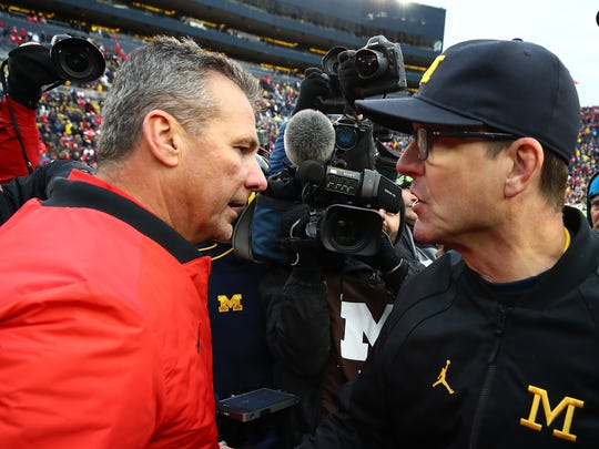 Urban Meyer was 7-0 against Michigan as Ohio State's coach, including a 4-0 mark against Jim Harbaugh.