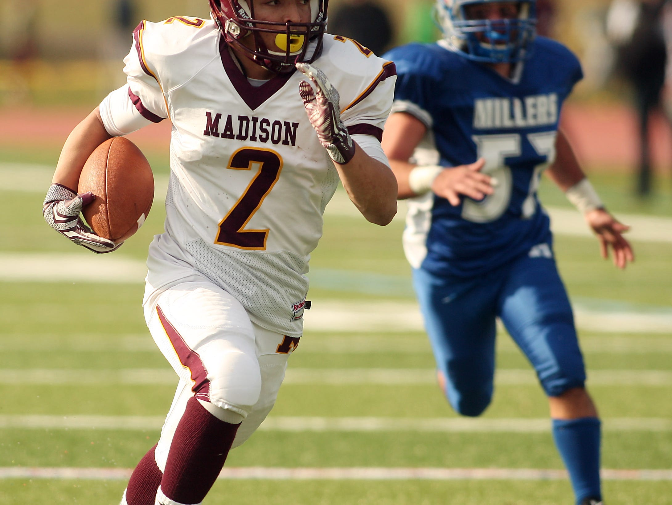 Madison receiver Joe Mobley takes the ball 39 yards for a touchdown at the end of the first half vs. Millburn during the 83rd renewal of their Thanksgiving Day rivalry Thursday morning in Millburn. November 26, 2015, Millburn., NJ.