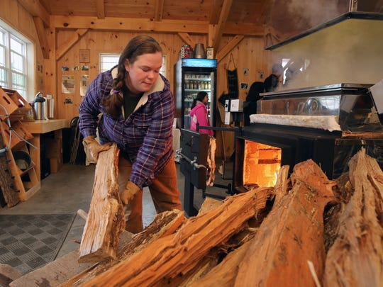 Jennifer Soukup stokes the fire in the evaporator at Soukup Farms in Dover Plains, as they make maple syrup March 25, 2017.