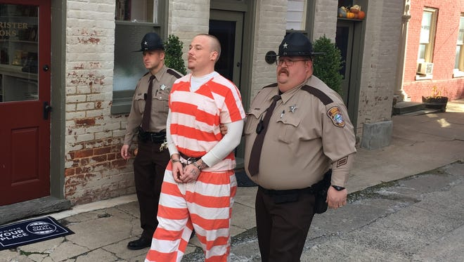 Matthew Wimer is escorted Friday from the Augusta County Courthouse after being sentenced to 23 years in prison.
