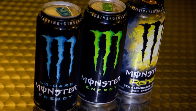 A photo illustration showing cans of Monster Energy.