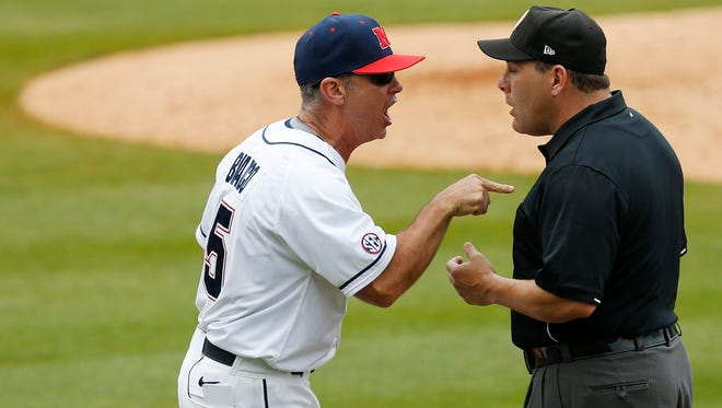 Coach Mike Bianco argues a call with first base umpire Ed Newsom during the third inning of a Southeastern Conference Tournament game last week. The ACC and SEC both have arguments for being the best baseball-playing conference in the country.