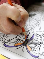 Adults color at the Brownsville Public Library in Dodge
