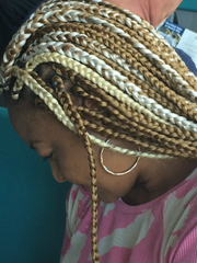 Braided woman in Montego Bay airport