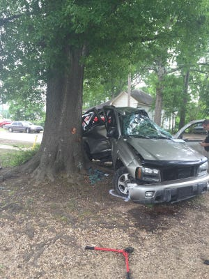A Mansfield High School student who was a passenger in this SUV died Wednesday afternoon in a single vehicle crash near the school The driver and two other passengers were injured.
