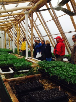 Johnson County officials tour a greenhouse in Madison, Wis., as apart of the county's trip to Dane County, Wis., earlier this week.