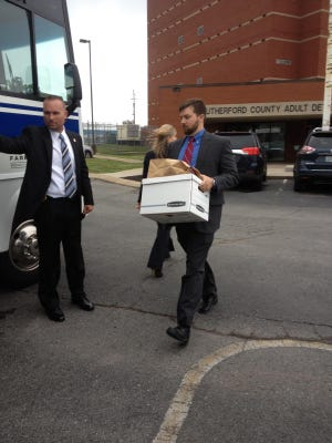 Agents remove boxes from the Rutherford County Sheriff's Office.