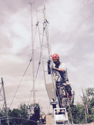 A worker from Northeast Towers building WCRC's new tower Thursday in West Nyack