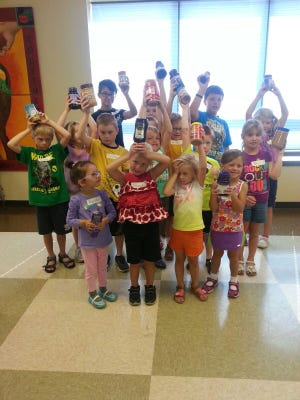 St. Mary's Springs Summer Childcare collected peanut butter and jelly, then volunteered to pack Brown Bag Lunches, learning lessons in giving from their experiences. Pictured front row, from left: Natalia Karewicz, Norah Specht, Adelyn Schumacher, Zosia Gill; second row, from left: Noah Schumacher, Katherine Howard, Lucas Babler, Justin Wagner, Kellan Gill, Michael Howard, Bri Maurice; back row, from left: Ashley Lambert, Jimmy Lambert, Jackson Schwartz (hiding behind Justin), Nate Rathkamp and Ashley Edmunds.