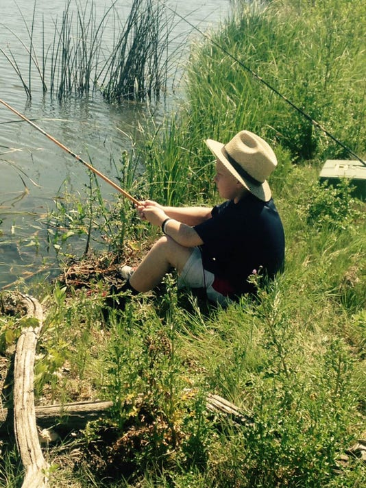 Joshua Rich of Myerstown fishing in the Arkansas River while on vacation in southeast Colorado.