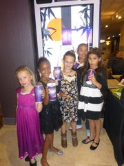 "Girl pals Ava Moyer, Laidyn Davis-Pena, Carly Orman and Cho Cho Yi celebrated Atia Bella Samuel's, at right, eighth birthday in style at the Palladium opening, including unlimited slushies and watching ""Minions"" on the luxurious power recliner seats."