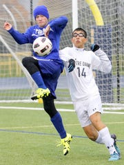 Trumansburg's Danny Lapp fights for control of the ball with Notre Dame's Aidan Sharma.