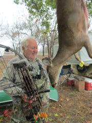 Dave Wood, Joplin, with a deer he shot with his bow.