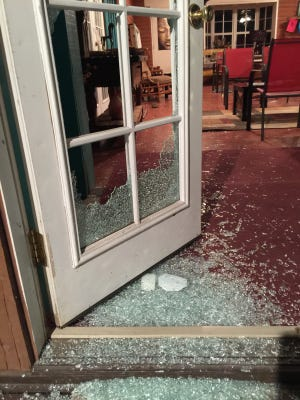 The broken door of Buddha Yoga may have been part of a Saturday night series of burglaries at nearby restaurants.