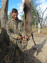 Nick Jarosz, Joplin, with his six point buck he shot in Dade County ove the weekend. Dade County is a non- antler restriction county for deer hunters.