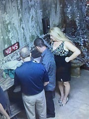 Brian Kocak, Brian Kocak Jr. and Laurie Kocak searching for clues in Cell Block M at Extreme Escapes.