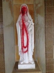 This statue at St. Colette Church in Livonia was vandalized over the weekend.