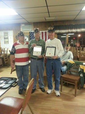 The Two Rivers American Legion Post 165 recently awarded World War II certificates to Richard Mott and Alfred Debauche. They were presented by Commander Rick Henrickson.