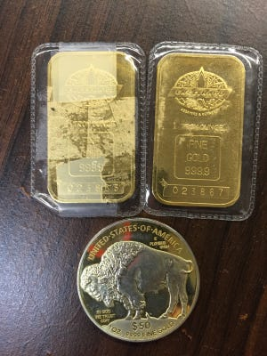 These gold bars, shown with another donation, helped the Salvation Army of Livingston County reach its Red Kettle fundraising goal.