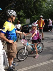 "Blue Ridge Bicycle Club president Joe Sanders introduces ""biking ambassador,"" Jenna Grabowski on a ride in Hendersonville last year. The club has pledged funds for the proposed Ecusta Trail to connect Hendersonville and Brevard along an old railroad line."