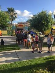 Customers wait their turn at Kona Dog food truck