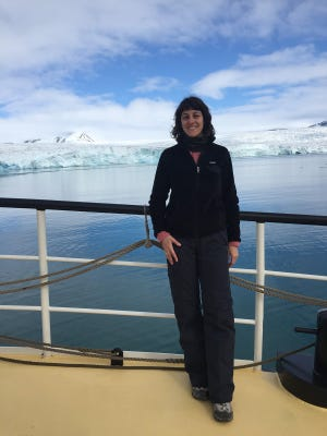 Megan Berner, a UNR photography professor who spent a three-week residency in the Arctic Circle, is pictured on the ship she stayed on during her residency last summer.