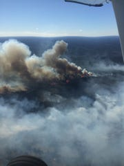 The Louisiana Department of Agriculture and Forestry did an aerial tour of the wildfire in Natchitoches Parish that was mostly contained by Thursday evening.