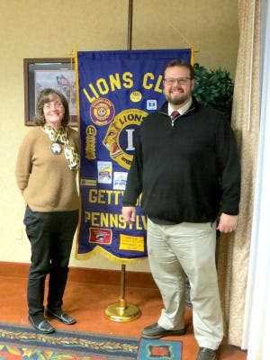 Gettysburg first vice president Maggie Baldwin, left, welcomes Ben Neely, of the Historic Society, to the Gettysburg Lions Club meeting.
