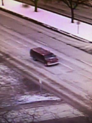 Police say this red cargo van was traveling down Woodward minutes before an abduction attempt occurred at a shopping center at Square Lake and Woodward.
